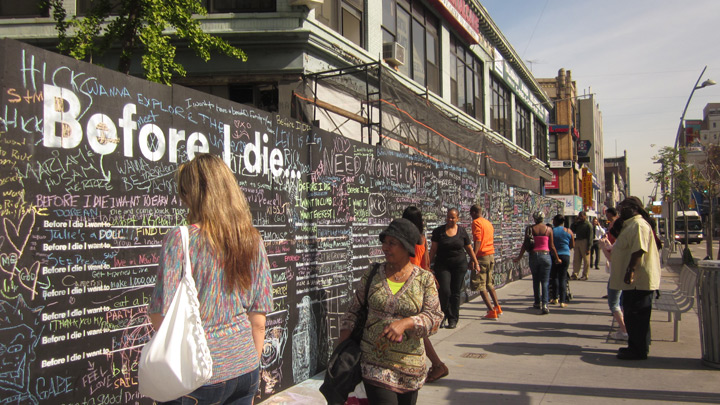 "People Writing on ""Before I Die"" Board - Public Art Project"