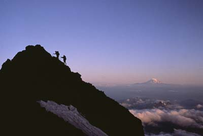 Climbing in Mt. Rainier National Park, Washington, with Mt. Adams in the distance. Climbing on ridge near Camp Muir. SCN0026399
