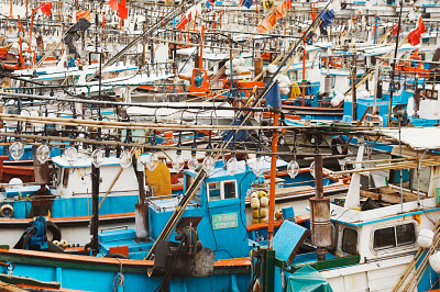 Fishing boats equiped with powerful lights to attract squid at night, Seogwipo harbor, Jeju-Do, South Korea AFS0216663