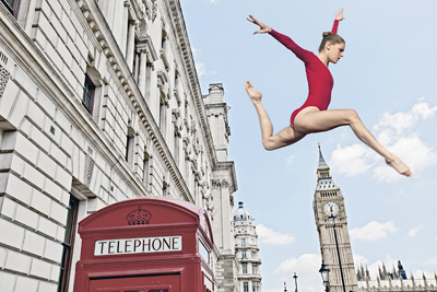 Gymnast leaping from telephone booth CUL0067491