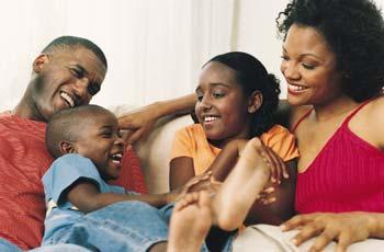 Playful Family on Sofa DVP0010677