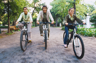 Couple riding bicycles with their daughter  STB0087704