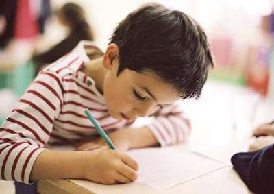 Child writing, close-up PHA0017524