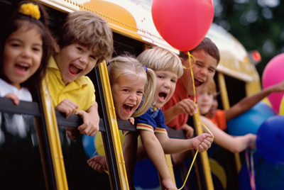 Group of children shouting on a school bus PUR0019929