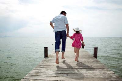 rear view of father and daughter running on pier BDG0017542