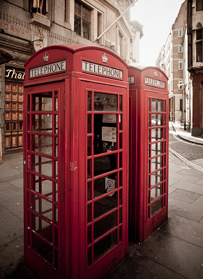 Red telephone box on city street CUL0079553