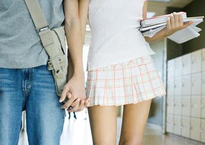 Teen couple walking in school hallway PHA0040267