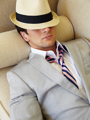 Trendy man napping on sofa BLD0107924