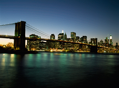 Looking Across The East River And The Brooklyn Bridge To The Financial District At Dusk AXM0003674