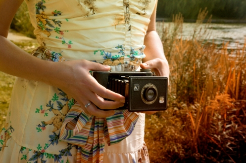 Woman Holding Folding Camera, High Park, Toronto, Ontario, Canada