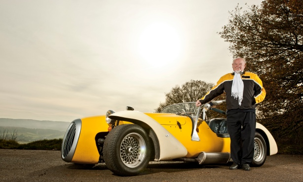 Older man standing with custom car  CUL0077340