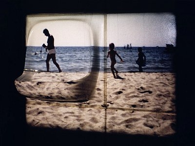 People on the beach (Super 8 Film Projection). ©Media Bakery #BRD0033289