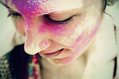 India, Ahmedabad, Young woman celebrating holi festival with powder paint. ©Media Bakery #WST0112105