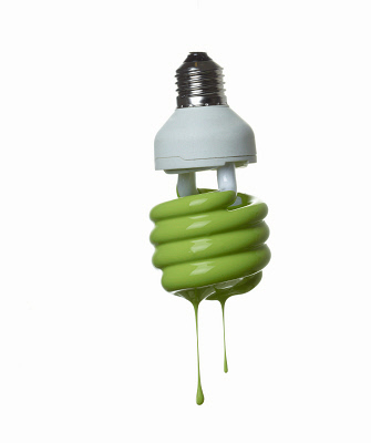 Fluorescent light bulb dripping in green. ©MediaBakery #CUL0088567