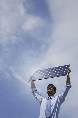 Businessman holding solar panel outside. ©MediaBakery #PTI0002853