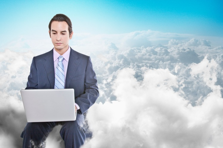 Media ID: BLD0107797 Mixed race businessman using laptop in clouds