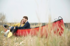 Media Bakery Young couple sitting in canoe