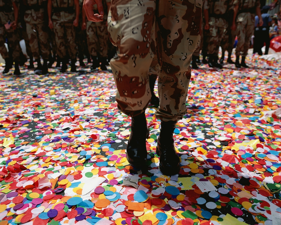 Solider walking in confetti after parade Media Bakery ID: PDI0041917
