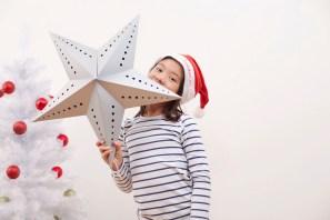 Media Bakery ID: IMS0235736 Girl holding up Christmas star, portrait