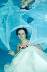 Image ID: ibxaaa02246695.jpg Woman presenting underwater fashion in pool, Odessa, Ukraine, Eastern Europe