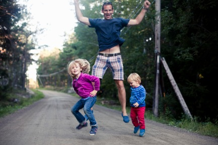 Media Bakery ID: MSK0002515 Excited father with two children jumping on country road