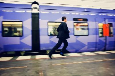 Media Bakery ID: MSK0003606 Young businessman running besides train on railway station platform
