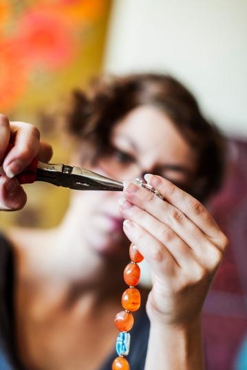 Media Bakery ID; MSK0003867Mid adult woman using pliers to make bead jewelry DIY
