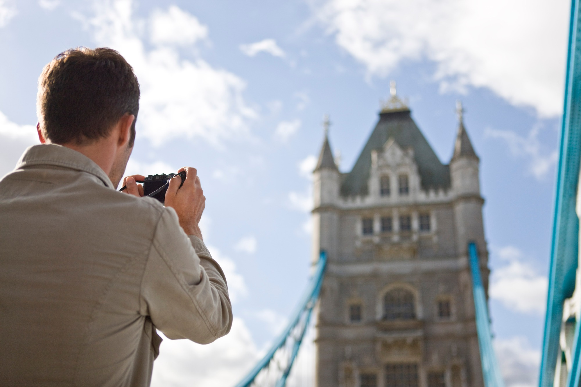 Media Bakery ID: LUV0016942 A mid-adult man taking a photograph of Tower Bridge