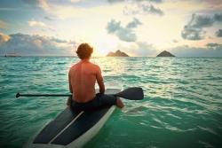 Media Bakery ID: BLD0151440 Caucasian man on paddle board in ocean