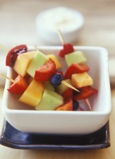 Media Bakery ID: BMS0009394 A bowl of fruit skewers.
