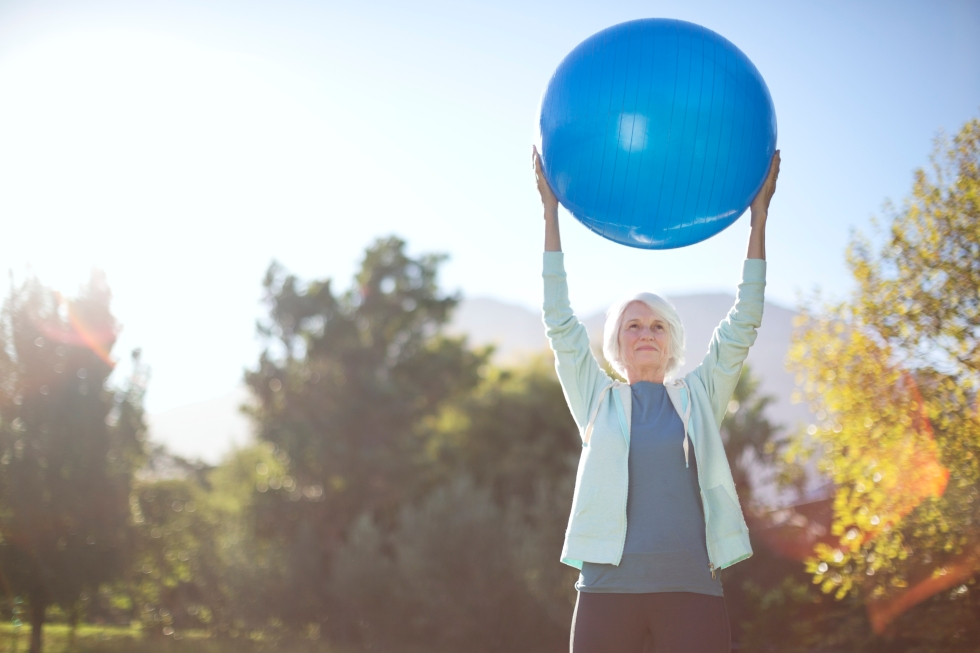 Media Bakery ID: CAA0007630 Senior woman holding fitness ball in park