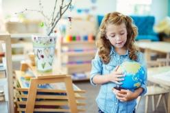 Media Bakery ID: CAA0017987 Student examining globe in classroom