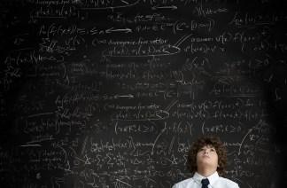 Media Bakery ID: IMS0153660 Boy in front of blackboard