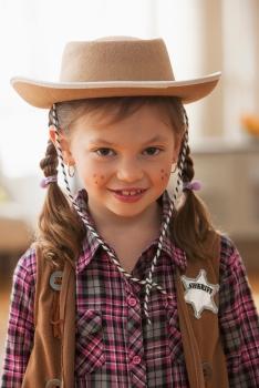 Media Bakery ID: BLD0128188 Caucasian girl wearing sheriff costume