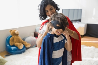 Media Bakery ID: HER0009410 Mother with son in superhero costume