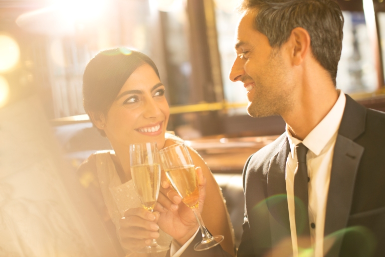 Media Bakery ID: CAA0013985 Well-dressed couple toasting champagne flutes in restaurant