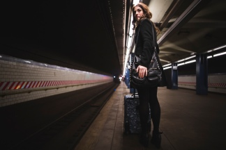 Media Bakery ID: IMS0244625 Young woman waiting in subway station, New York, USA