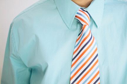 MediaBakery_BLD0012195 Man wearing pastel shirt and stripe tie
