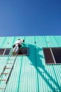 Construction Worker on Ladder --- Image by © Steve Hix/Somos Images/Corbis