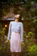 A young, pretty Asian woman in a garden in Hanoi, Vietnam.
