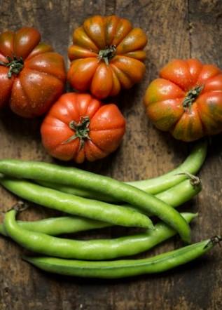 fava bean and fresh tomato --- Image by © Carlo Vigni/Corbis