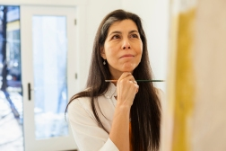 Hispanic artist working in studio