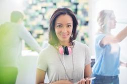 Portrait confident creative businesswoman with headphones in office