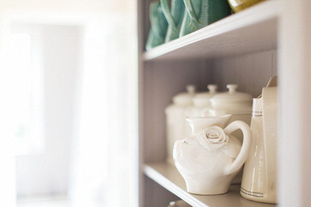 Close up of ceramics on kitchen shelf