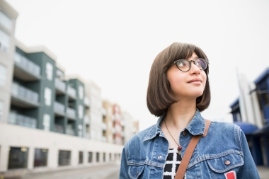 Woman in denim jacket on urban street