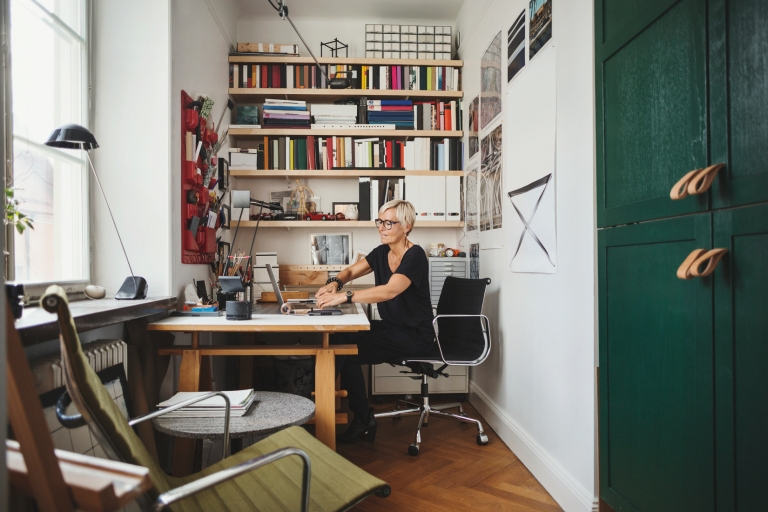 Mature product designer working at home office