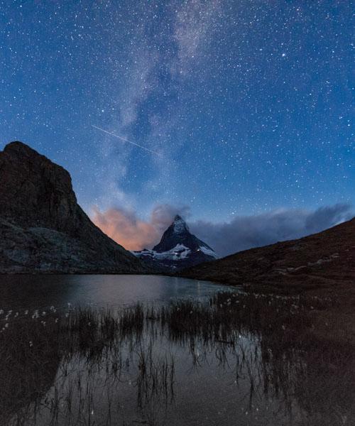 Stars and Milky Way above the Matterhorn reflected in Lake Stellisee, Zermatt, Canton of Valais, Swiss Alps, Switzerland, Europe