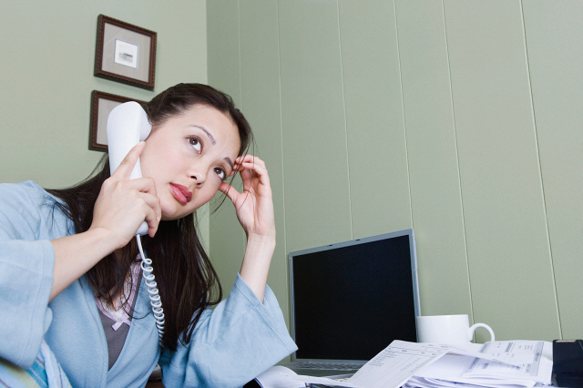 Stressed woman talking on telephone