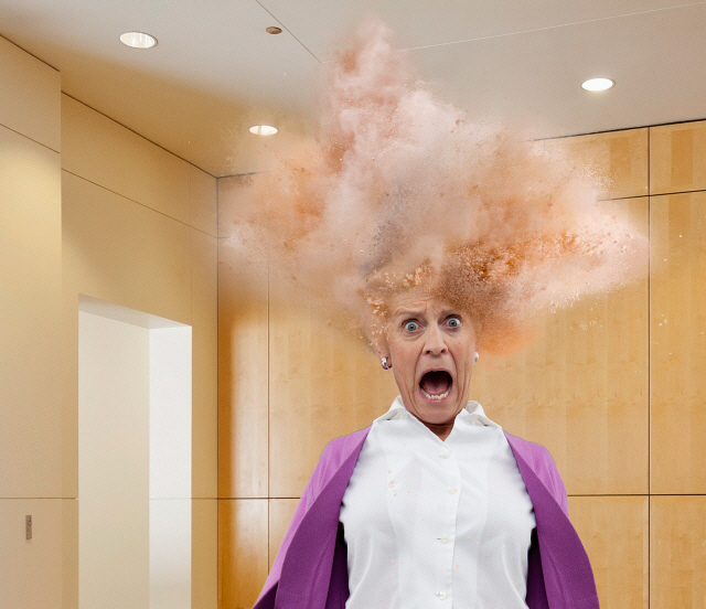 Head of Caucasian businesswoman exploding